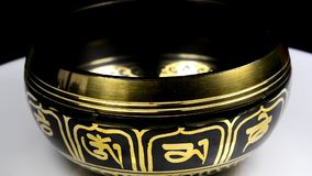 Singing bowl from Nepal on a turn table