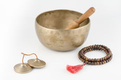 Singing Bowl, Prayer Beads and Meditation Bells. Royalty Free Stock Photography