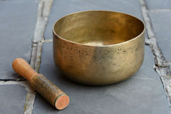 Singing bowl and stick Royalty Free Stock Images