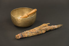 Singing Bowl with Wooden Ringing Stick and Smudge Stick. Royalty Free Stock Images