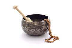Singing bowl and wooden rosary. Stock Images