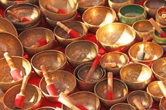 Singing bowls of bronze. Golden singing bowls are sold on the ma stock photo