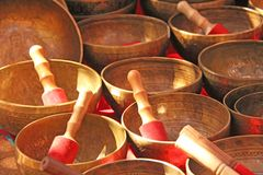 Singing bowls of bronze. Golden singing bowls are sold on the ma stock images