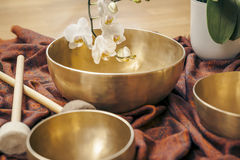 Singing bowls. An image of some singing bowls and a white orchid royalty free stock image
