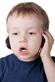 Singing boy. With headphones isolated over white stock photos