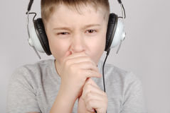 Singing boy. In headphones with copy space royalty free stock images
