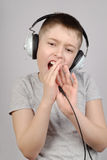 Singing boy Stock Images