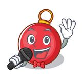 Singing Christmas ball character cartoon Royalty Free Stock Images