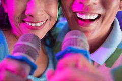 Singing couple Stock Image