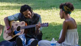 Singing Couple in Piedmont Park, Atlanta royalty free stock photography
