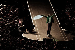 Singing for the crowd. The italian singer Lorenzo Jovanotti Cherubini opening wide his arms for the frenzied crowd Royalty Free Stock Photography