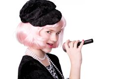 Singing Diva. Coy preteen diva singing into a microphone. Isolated on white stock photos