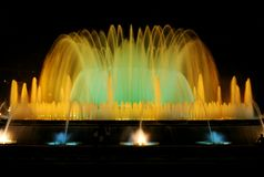 The singing fountain in Barcelona. The singing fountains. One of the most interesting dostoprimechatelsty Barcelona Spain. The fountain changes the colors and royalty free stock images