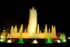 The singing fountain in Barcelona. The singing fountains. One of the most interesting dostoprimechatelsty Barcelona Spain. The fountain changes the colors and stock photos