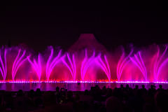 Free Singing Fountains. Glowing Colored Fountains And Laser Show. Stock Image - 79883911