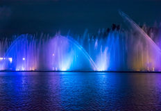 Singing fountains. Glowing colored fountains and laser show. Royalty Free Stock Image