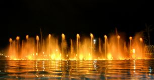 Singing fountains. The singing fountains. One of the most interesting dostoprimechatelsty Salou Costa Dourada in Spain. The fountain changes the colors and Royalty Free Stock Photo