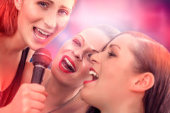 Singing friends karaoke Stock Photos