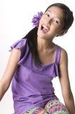 Singing girl. Picture of a girl enjoying singing stock photo