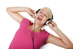 Singing girl with headphones on floor Royalty Free Stock Photos