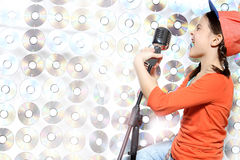 Singing girl in the orange cap Royalty Free Stock Photos
