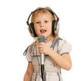 Singing girl in recording studio Royalty Free Stock Photo