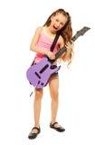 Singing girl rocks playing on electro guitar Stock Photo