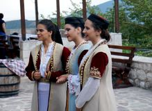 Singing girls. Beautiful dancers and singers at the nice folk style evening meal in Montenegro stock image