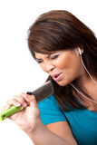 Singing Into a Hair Brush Royalty Free Stock Photography