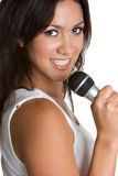 Singing Hispanic Woman. Pretty hispanic karaoke woman singing Royalty Free Stock Photo