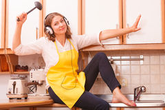 Singing housewife at home Stock Photo