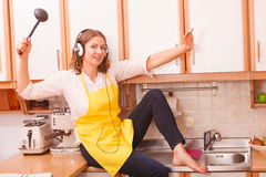 Singing housewife at home Royalty Free Stock Photo