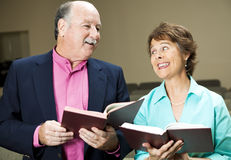 Singing From Hymnal. Husband and wife in church, singing hymns Royalty Free Stock Photo