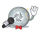 Singing IOTA coin character cartoon. Vector illustration Royalty Free Stock Photo
