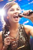 Singing karaoke Stock Photos