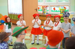 Singing kindergarten children. Group of dressed children singing songs at a mother's day event in Poznan, Poland Royalty Free Stock Photos