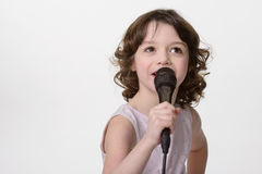 Singing lovely girl with mic Royalty Free Stock Photo