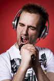 Singing man. Singing young man wearing headphones Stock Image