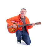 Singing man with electric guitar Royalty Free Stock Image