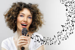Singing into a microphone Royalty Free Stock Photo