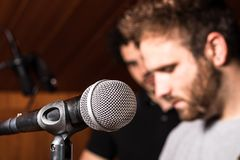 Singing microphone. And background singers stock image