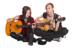 Singing musicians with guitars Royalty Free Stock Image