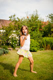 Singing is my joy. Happy childhood - child singing with microphone outdoor in backyard Stock Photography