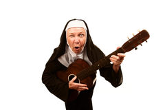 Singing Nun. Portrait of eccentric singing nun with evil expression on her face stock photo