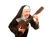 Singing Nun. Funny singing nun with old guitar and religious habit Royalty Free Stock Images