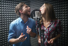Singing people. Young singers with a microphone Stock Image