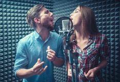 Singing people. Young singers with a microphone Royalty Free Stock Image