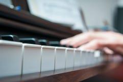 Singing at the piano Stock Photos