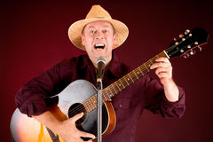 Singing and Playing Acoustic Guitar Royalty Free Stock Photography