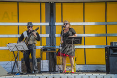 Singing and playing rockabilly at the fish market Royalty Free Stock Photo